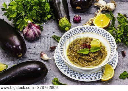 Eggplant Dip Baba Ganoush (mutabbal) Or Mezze With Ripe Vegetables And Fresh Herbs
