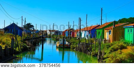 multicolored oyster sheds and river at Oleron Island