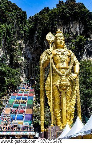 Big Statue Of Hindu Lord At Batu Caves Temple In Malaysia, Hindu Religion Lord Big View At Batu Cave