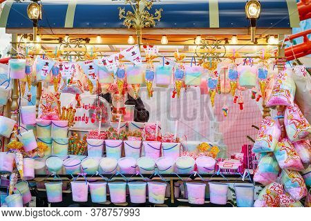 London, Uk - November 25, 2019 - Carnival Cart Selling Candy Floss And Other Sweets At Christmas Fun