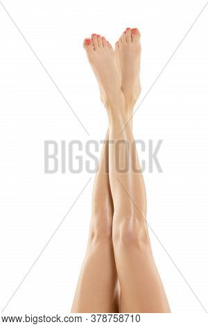 Tender Touch. Beautiful Female Legs Isolated On White Background. Beauty, Cosmetics, Spa, Depilation