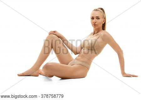 Tender Touch. Beautiful Woman In Underwear Posing Isolated On White Background. Beauty, Cosmetics, S