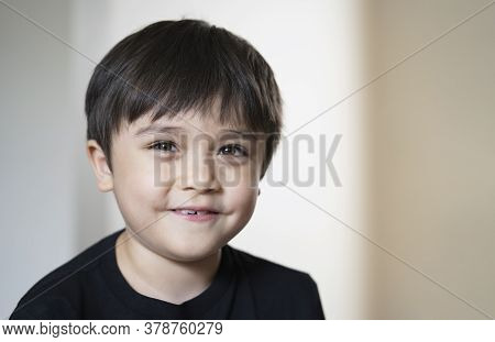 Close Up Head Shot Kid Looking At Camera With Smiling Face With Copy Space, Healhty Child With Happy