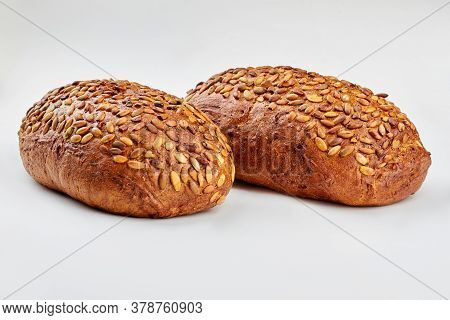 Organic Wholmeal Bread On White Background. Two Loaves Of Artisan Bread With Pumkin Seeds. Healthy B