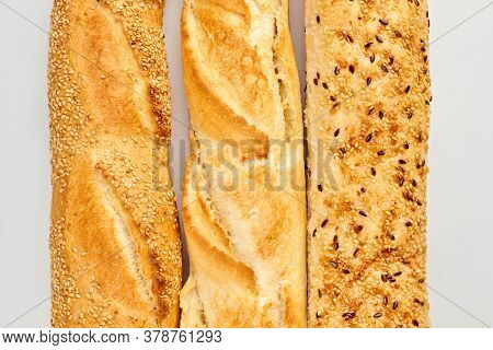 Close Up Of Baguettes With Sesame And Flax Seeds. Long Bread Loaves With Crust. Delicious Homemade C