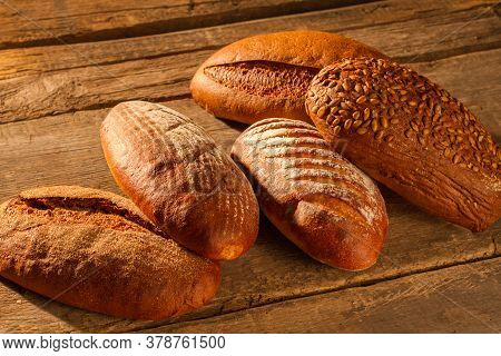 Wholemeal Wheat Bread On Wooden Background. Healthy Bread With Crust On Table. Organic Food Concept.