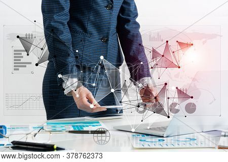 Businesswoman Standing Near Office Desk With Laptop And Documents. Financial Audit And Consulting. C