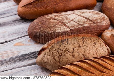 Artisan Bread Loaves Close Up. Assorted Organic Bread On Wooden Background. Healthy Food Shop.