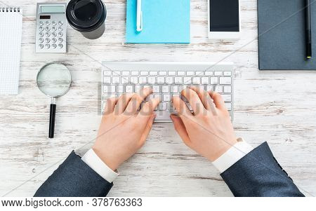 Businessman Typing At Computer Keyboard At Wooden Desk. Well Organized Office Workspace With Digital