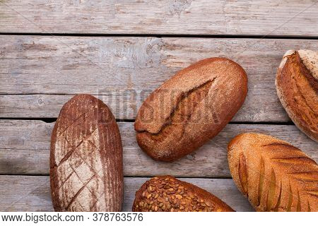 Natural Organic Bread Assortment On Wooden Background. Artisan Whole Wheat Bread On Wood Planks. Rus