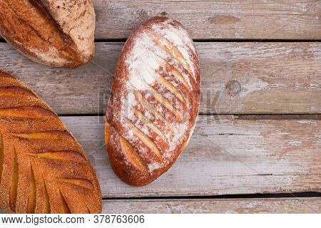 Artisan Bread On Wooden Background. Freshly Baked Homemade Bread With Crust. Space For Text.