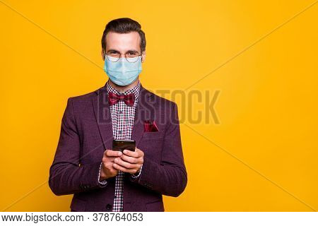 Portrait Of His He Nice Attractive Imposing Guy Wearing Safety Gauze Mask Using Device 5g App Order