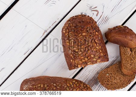 Whole Grain Bread On Wooden Background. Natural Wholemeal Bread.