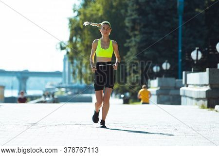 Purposeful. Female Runner, Athlete Training Outdoors. Professional Runner, Jogger Working Out On The