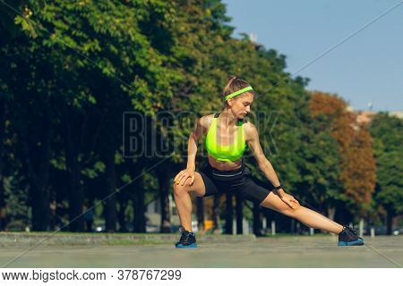 Stretching. Female Runner, Athlete Training Outdoors. Professional Runner, Jogger Working Out On The