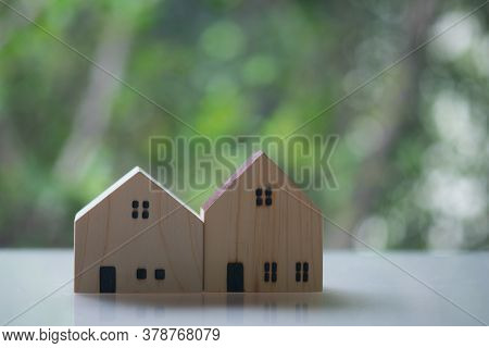 Two Of Lovely Small Model House With Nature Green Bokeh Sunlight Abstract Background. New Property I