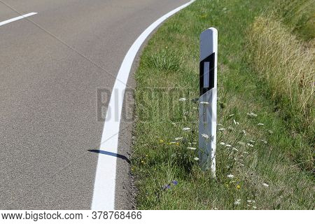 Roadside Post On A Country Road In Germany
