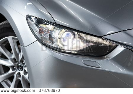 Novosibirsk/ Russia - June 10 2020: Mazda 6,  Silver Car Headlights. Exterior Detail. Close Up Detai