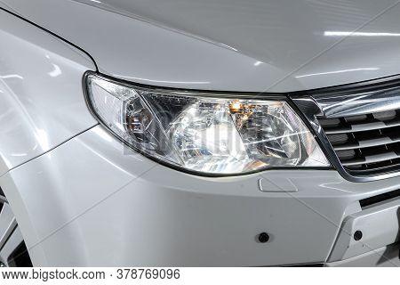 Novosibirsk/ Russia - June 23 2020: Subaru Forester,  White Car Headlights. Exterior Detail. Close U