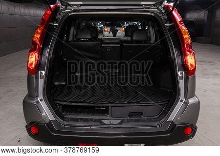 Novosibirsk/ Russia - April 28  2020: Nissan X-trail,  Close-up Of The Open Trunk, Headlight, Bumper