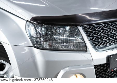 Novosibirsk/ Russia - June 30  2020:  Suzuki Grand Vitara,  Silver Car Headlights. Exterior Detail.