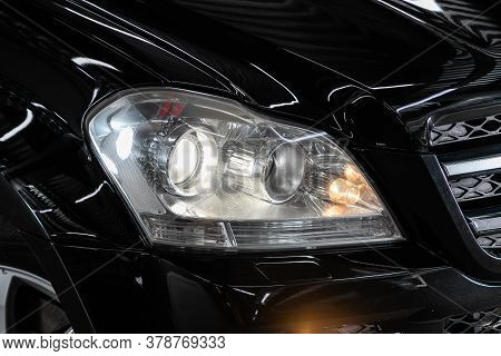 Novosibirsk/ Russia - July 18  2020: Mercedes Benz Gl-class,  Black Car Headlights. Exterior Detail.