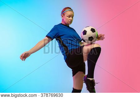 Bouncing Ball. Female Soccer, Football Player Training In Action Isolated On Gradient Studio Backgro