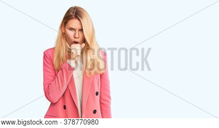 Young beautiful blonde woman wearing elegant clothes feeling unwell and coughing as symptom for cold or bronchitis. health care concept.