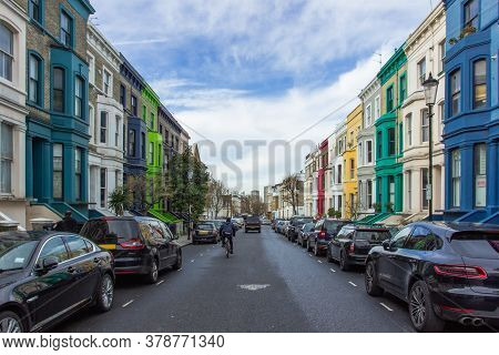 Residential Street With Colorful Houses In Notting Hill, London, Uk. Typical English Houses Facades