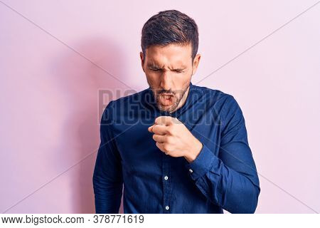Young handsome man wearing casual shirt standing over isolated pink background feeling unwell and coughing as symptom for cold or bronchitis. Health care concept.