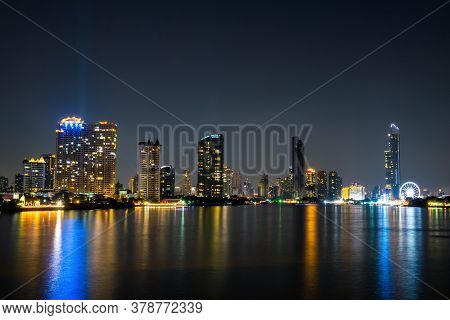 Landscape And Cityscape. Building Along The Chao Phraya River At Night. At Asiatique The Riverfront