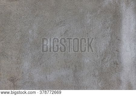 A Pattern On A Rough Stucco Wall
