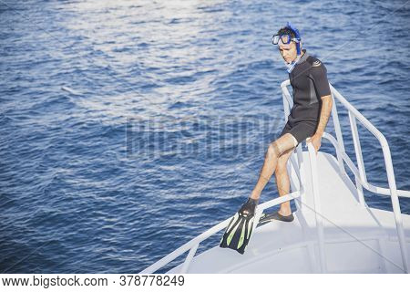Ras Muhhamed Nature Reserve, Egypt, March 2020: Diver In Swimming Equipment Stand At The Bow Of The