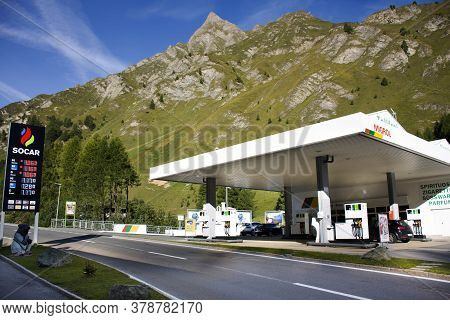 Austrian People And Foreign Travelers Fill Oil To Tank Of Car In Petrol Station At Kaunertal Municip