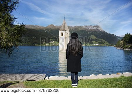 Traveler Asian Thai Woman Travel And Posing For Take Photo At Submerged Tower Of Reschensee Church D