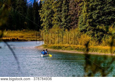Canoeists On The River. Marsh Loop, Banff National Park, Alberta, Canada