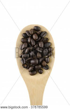 Dark Roasted Coffee Beans Is On A Wooden Spoon Isolated On A White Background Without A Shadow.
