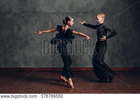 Young Couple Dancing In Ballroom Dance Cha Cha Cha.