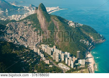 Aerial View Of Two Brothers Mountain With Biggest In Brazil Favela Rocinha And Apartment Buildings A