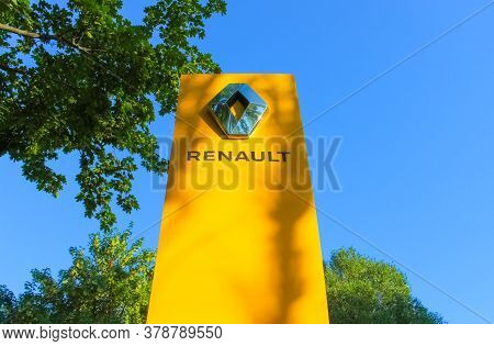 Kyiv, Ukraine - July 29, 2020: Renault Dealership Sign Against Blue Sky. Renault Is Known For Its Ro