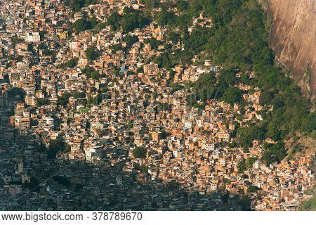 Aerial View Of Favela Rocinha In Rio De Janeiro, Which Has 100,000 Inhabintants And Is The Largest I