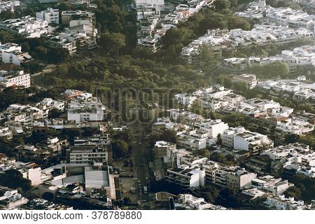 Aerial View Of Houses With Streets With Trees Between Them