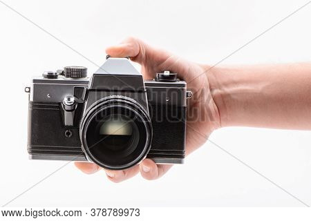 Hand Holding A Retro-style Camera On White Background