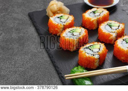 homemade california rolls, mad of crab sticks, avocado, cucumber inside. tobiko(flying fish roe) outside.