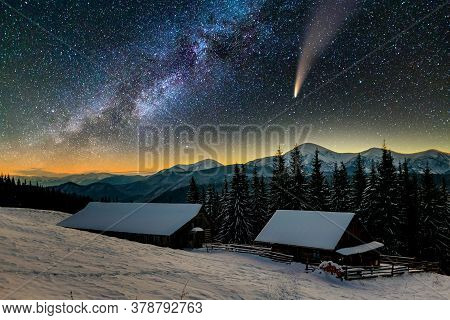 Surreal View Of Night In Mountains With Starry Dark Blue Cloudy Sky And C/2020 F3 (neowise) Comet Wi