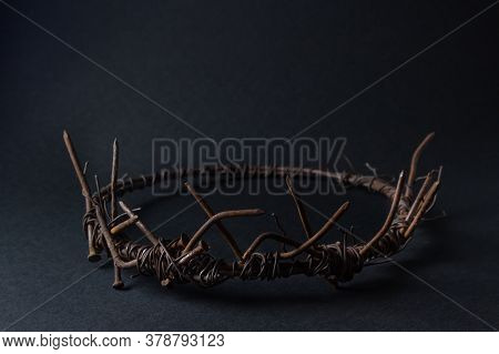 Crown On A Black Background. A Crown Made Of Rusty Nails And Wire. Lie Power