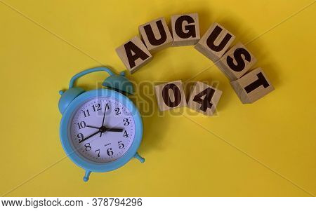 August 4.august 4 On Wooden Cubes On A Yellow Background.photos For The Holiday .the Last Month Of S