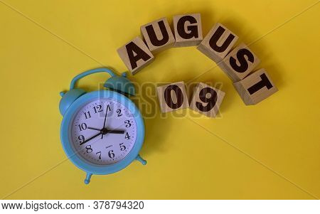 August 9.august 9 On Wooden Cubes On A Yellow Background.photos For The Holiday .the Last Month Of S