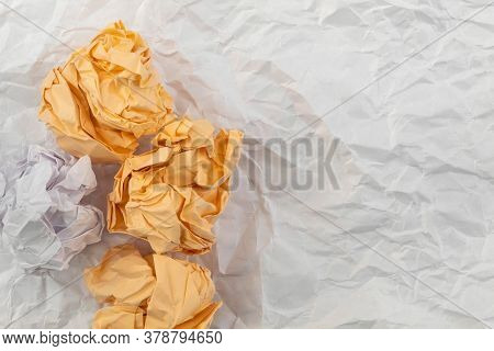 On White Crumpled Paper There Are Four Heavily Crumpled Papers Of Two Colors