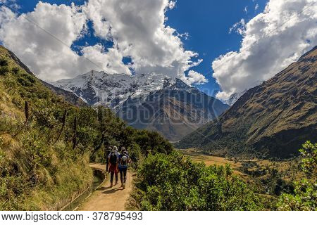 Four Persons Trekking Towards Salkantay Mountain Near Cusco, Peru.